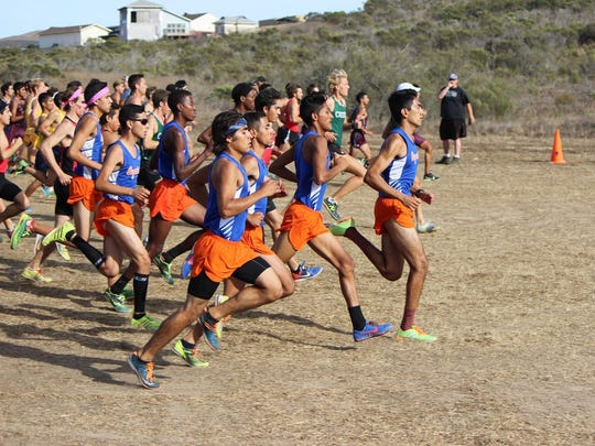 Former Redwood standout and COS Giant Adam Gonzalez leads the pack in a cross country race in Modesto.