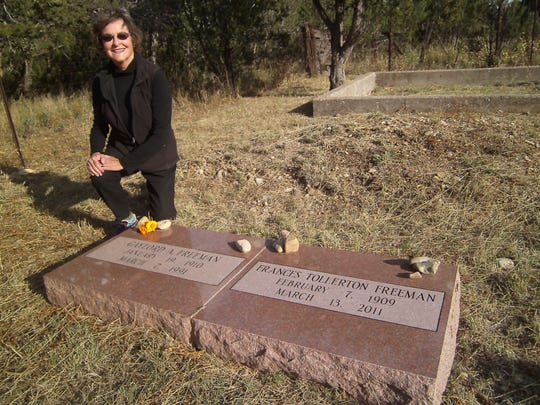 Clara Freeman Farah places chrysanthemums on the graves of her parents Gaylord and Frances Freeman who, with the Henns and Robert O. Anderson, established the LIncoln Heritage Trust.