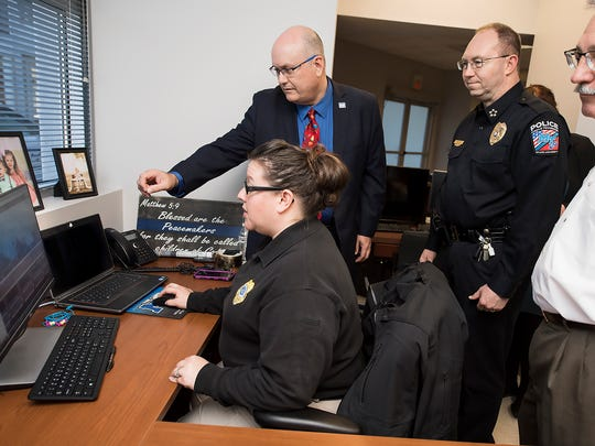 MTSU Police Lt. Kim Rednour, seated, explains the features of the university's upgraded video surveillance system Thursday, Dec. 1, at the campus police department's precinct inside the Miller Education Center on Bell Street. From top left are Andrew Oppmann, MTSU vice president of marketing and communications, University Police Chief Buddy Peaster and Bruce Petryshak, vice president for information technology.