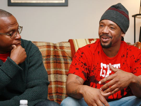 Portage resident Ahkir Hunter, 36, (right, seated next to Lansing resident Gant-Bey) discusses getting his foot in the door for a job opportunity following his incarceration.