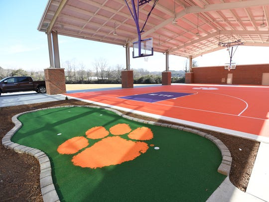 A basketball court and putting green in the outdoor