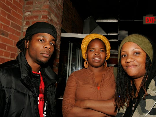 Maurice Bailey with Black August members Danielle Ponder and Denise Reese at Tilt nightclub for the Giant Panda Guerilla Dub Squad CD release party in 2006.
