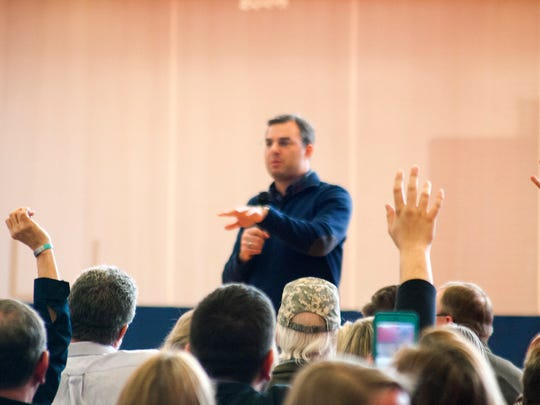 U.S. Rep. Justin Amash, R-Cascade Township, went well over the allotted time of his town hall Thursday in Battle Creek, continuing to take questions from constituents.  Congressman Justin Amash took questions from the audience Thursday afternoon during his Town Hall meeting at Full Blast in Battle Creek