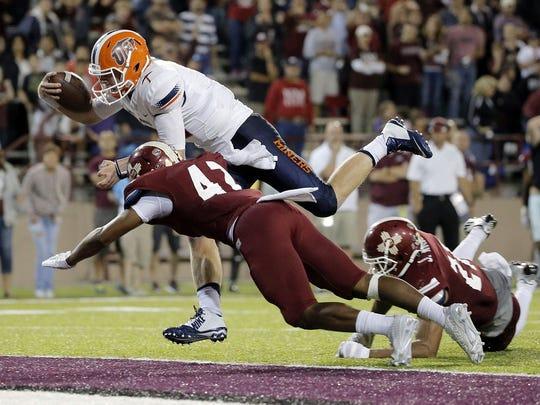 2015: UTEP quarterback Ryan Metz dives into the endzone