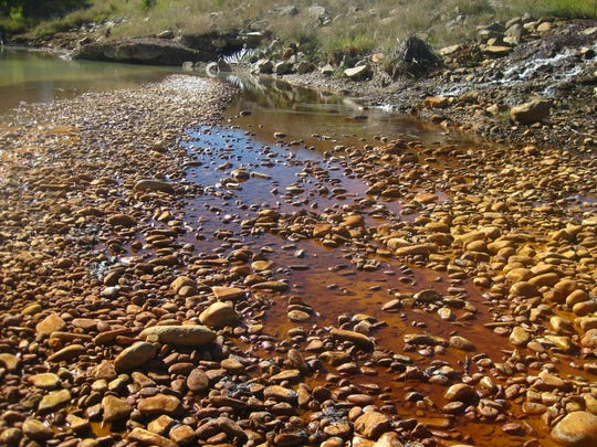 Acid mine pollution discharges into to Belt Creek from