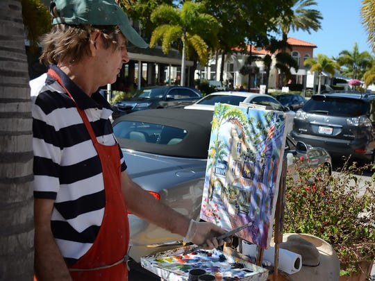 In this file photo, Paul Arsenault paints just outside his gallery on Third Street South in Old Naples.