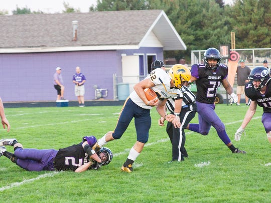 Portage Central's Kris Hodgson (22) gets tripped up