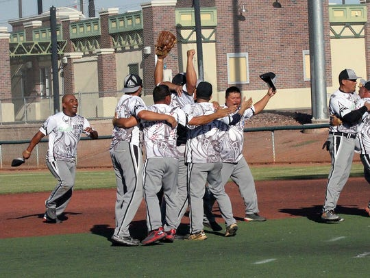 Players from Bud Light Guam celebrate the final out
