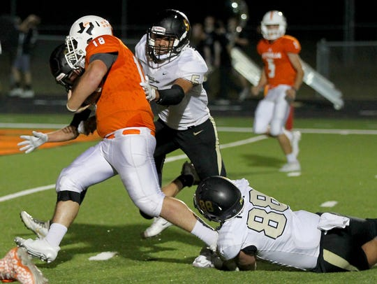 Petrolia quarterback Macon Armour runs the quarterback