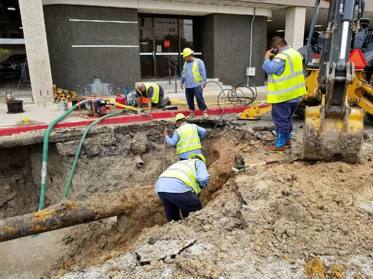 City crews work on repairing a water main break in the 500 block of North Tancahua Street. There is no definite cause for the break, but city officials said old infrastructure could have caused the break.