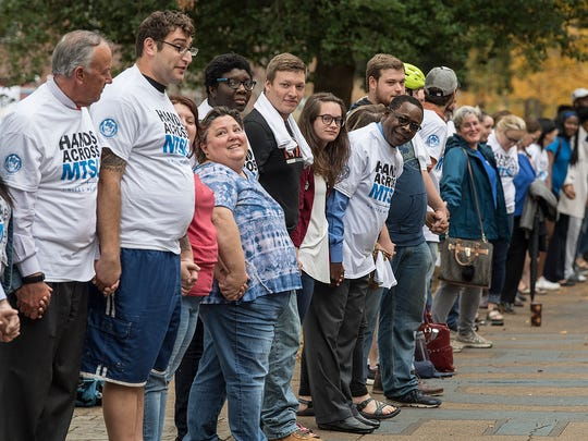 MTSU President Sidney McPhee takes a look at those participating in the university's Hands Across MTSU event, led by the Student Government Association.