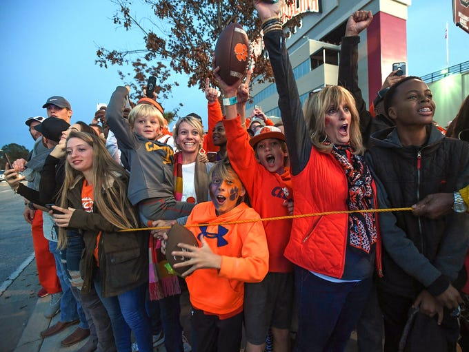 Clemson fans wait on the team to arrive at Carolina's