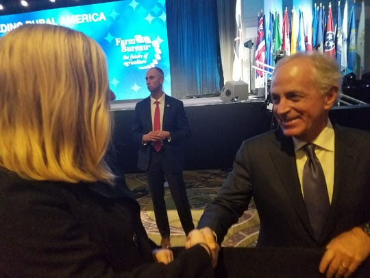 One of Stephen Eimers' daughters shakes the hand of U.S. Sen. Bob Corker, R-Tennessee. Eimers attended President Trump's speech in Nashville on Monday, Jan. 8.