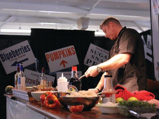 Chef Kevin Des Chenes prepares food at a past Hudson