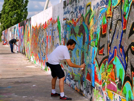 A few stretches of the Berlin Wall still stand, such