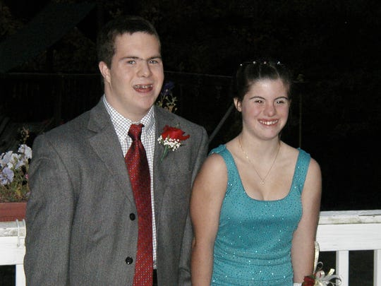 Photo Undated: Ryan Mavriplis and Jillian Daugherty, decked out for one of the high school homecoming dances. Jillian Daugherty, now 25, and Mavriplus, 27, who also has Down syndrome, will marry June 27. They've been together 10 years.