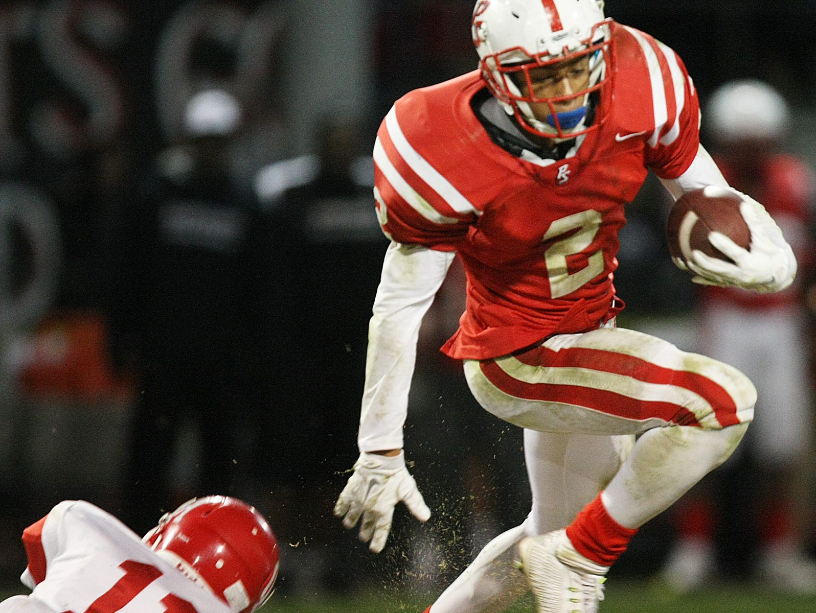 Tayler Hawkins high steps out of a tackle as Palm Springs plays Oak Hills in their CIF semifinal football game at Palm Springs High. The Indians won 27-23.