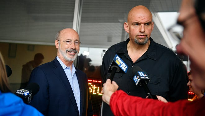 Pennsylvania Gov. Tom Wolf and John Fetterman, Democratic nominee for lieutenant governor, answer questions form the media outside the Manchester Cafe Wednesday, May 16, 2018, in Manchester Township. Fetterman, a Central York alumnus and currently the mayor of Braddock, won the Democratic nomination for lieutenant governor Tuesday evening. Wolf, a York County native, is running for his second term as Pennsylvania governor.