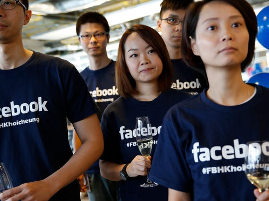 In July Facebook staff attend the opening ceremony of their new office in Hong Kong. The social networking service has attracted 1.1 billion users in foreign markets versus 200 million in the U.S. and Canada.