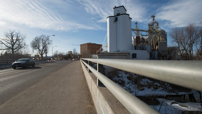Traffic travels over the Cache la Poudre River on the Lincoln Avenue bridge Tuesday in downtown Fort Collins. Demolition of the bridge is set to start Jan. 9.