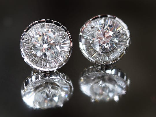 Classic taken to the next level are 3 carat total weight  stud earrings at $19,500 with a diamond jacket of 1.31 total weight white gold $3,950.