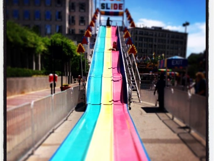 A child tries the Fun Slide at #cincytaste.