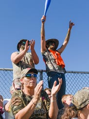 Fans cheer on the Trojans during a PIAA Class AAAA