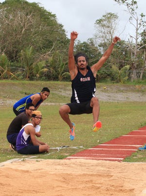 Michael Alicto competes in the long jump during the Guam track and field national championship at Okkodo High School on Saturday, June 6.