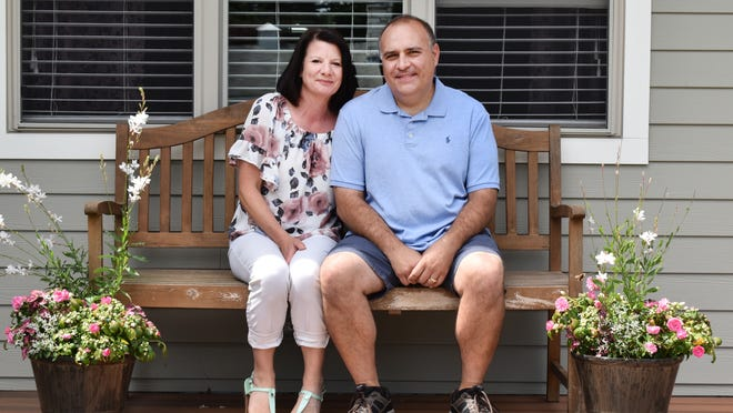 Jennifer and Bob Ledo enjoy a beautiful day on their front porch in Somerset now that he has recovered from COVID-19.