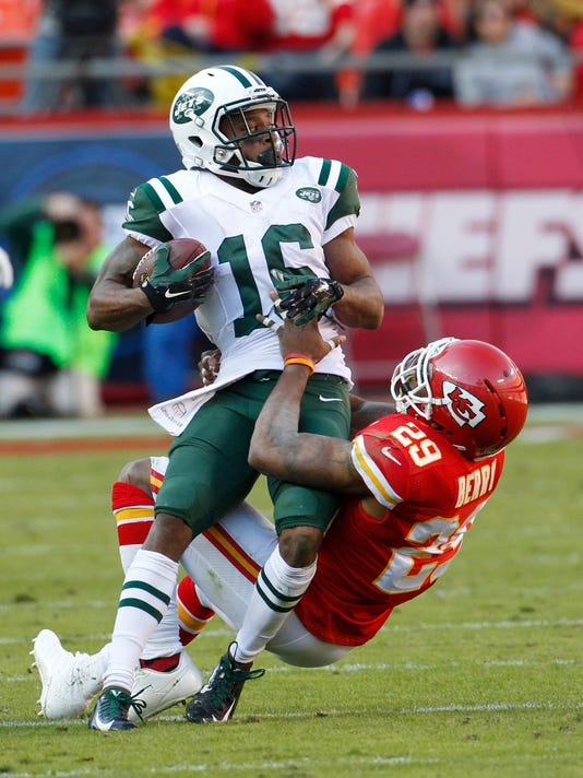 New York Jets wide receiver Percy Harvin (16) is pulled down by Kansas City Chiefs strong safety Eric Berry (29) in the second half of an NFL football game in Kansas City, Mo., Sunday, Nov. 2, 2014. (AP Photo/Colin E. Braley)