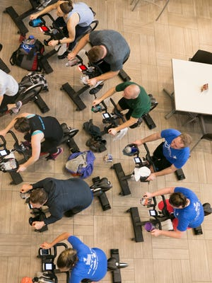 Exercisers during a YMCA cycle-a-thon, designed to raise funds for the center through a day of $25 spin classes in the Irsay Family YMCA's annual campaign, Indianapolis, Saturday, Feb. 24, 2018.