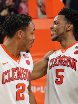 Clemson guard Marcquise Reed (2) and forward Jaron Blossingame (5) celebrate after their 78-74 win over N.C. State after the game on Saturday in Littlejohn Coliseum in Clemson.