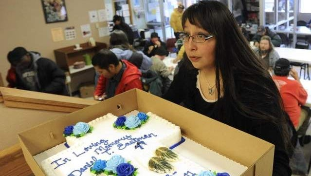 Rhiannon Vasquez brings a cake for a November 2011 memorial for her dad, Daniel Eastman, at Good Shepherd Center in Sioux Falls.