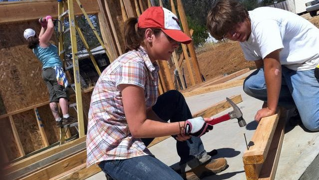 Tess Kersten (left) and R.J. Ellicock help build a Habitat for Humanity home on West Street in Shasta Lake in 2010. They were part of a volunteer group from Redding Bank of Commerce.