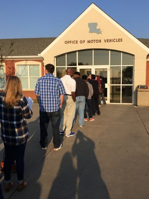 The line was already 30 deep  just before the Louisiana Department of Motor Vehicles' office in Monroe opened Tuesday morning.