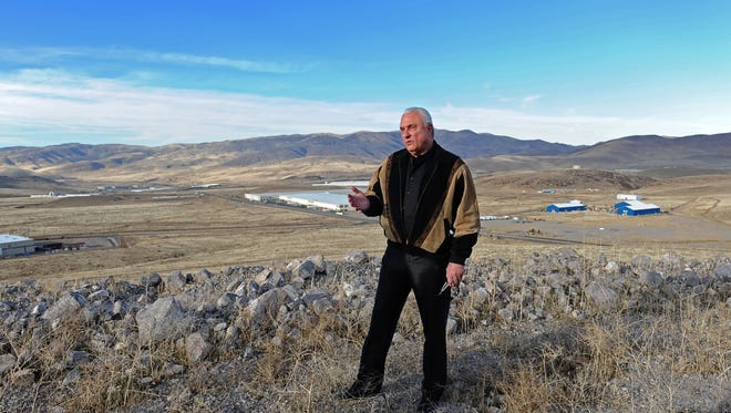 Lance Gilman stands overlooking the Tahoe Reno Industrial Center on in 2011.