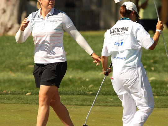 Brittany Lincicome hands her putter to her caddie on No. 17 during the second round of the ANA Inspiration at Mission Hills Country Club in Rancho Mirage on Friday.
