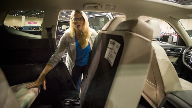 October 27, 2017 - Volkswagen representative Amanda Klinga shows off the interior of the new seven-passenger VW Atlast during the Memphis International Auto Show at the Cook Convention Center. Classic cars and the newest models are on display showcasing everything from the practical to the luxurious. The show continues through Sunday.