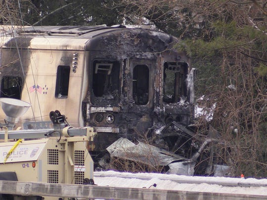 The aftermath of the Feb. 3 collision between a Metro-North train and an SUV on Commerce Street in Valhalla. The vehicle's driver and five train passengers were killed.
