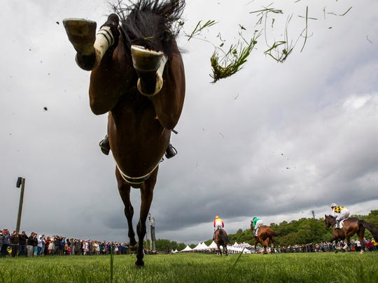 Horses clear the first jump during the Winterthur Bowl race at the 39th Annual Point-to-Point at Winterthur in Greenville on Sunday afternoon.