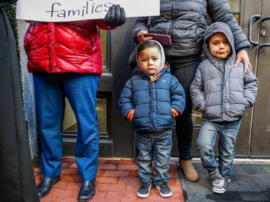 """Zahyra Arenas stands with her two sons, Aaron, 4, and Alexander, 2, during a DACA protest in front of Indiana Senator Joe Donnelly's office on Pennsylvania Street in Indianapolis on Tuesday, March 6, 2018. Arenas is a Dreamer. """"I'm nervous because this is still in limbo for us and our families,"""" she said."""
