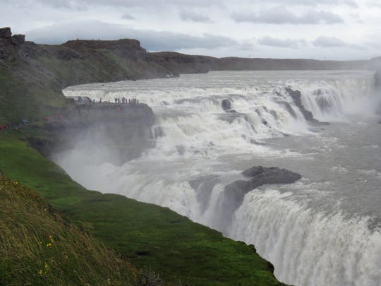Tourists can get up close and personal to some of Iceland's beautiful waterfalls.