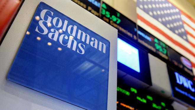 File photo taken in 2014 shows a sign of U.S. bank Goldman Sachs on the floor of the New York Stock Exchange in New York City.