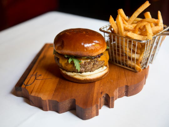 A Jeff Ruby burger is served at all of the Jeff Ruby