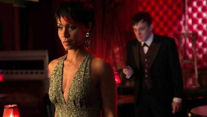 "This image released by Fox shows Jada Pinkett Smith, left, and Robin Lord Taylor in a scene from ""Gotham,"" premiering Sept. 22. (AP Photo/Fox, Jessica Miglio)"