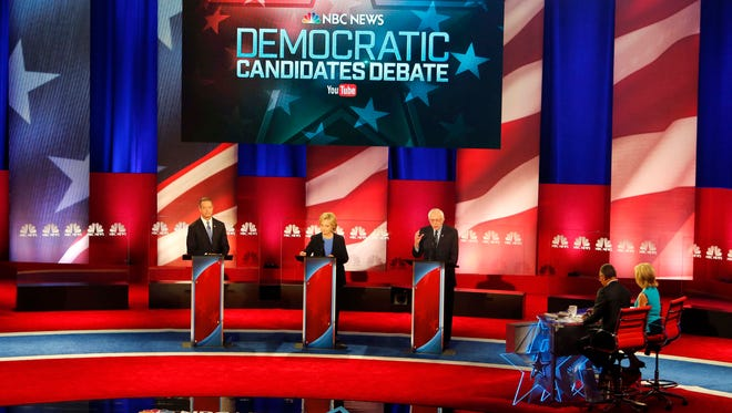 Bernie Sanders delivers his opening statement at the NBC-YouTube Democratic presidential debate at the Gaillard Center on Jan. 17, 2016, in Charleston, S.C., alongside Martin O'Malley and Hillary Clinton.