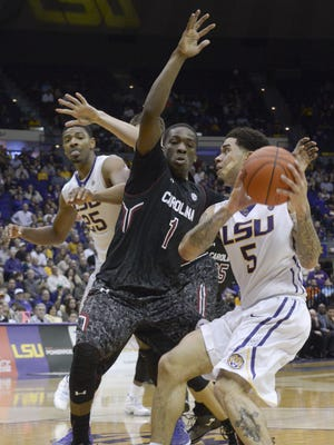 LSU's Josh Gray (5) looks to pass around South Carolina's Marcus Stroman (1) during the Tigers' 64-58 victory Wednesday night. Gray helped spark LSU's decisive 12-2 run in the win.