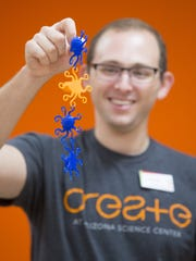 Steven Weiner, Director of Programming at Arizona Science Center, links octopus together made from a 3D printer at Create in Phoenix. Create offers the community the space and resources to learn while doing.