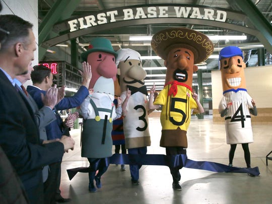 The Klement's Racing Sausages cut the ribbon for the unveiling of their Brewers Food & Beverage Reimagined event, March 29, 2017, at Miller Park.