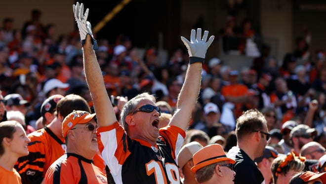 Cincinnati Bengals fans show their spirit during their game against the Atlanta Falcons at Paul Brown Stadium. The Enquirer/Jeff Swinger